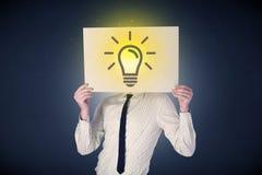 Het document van de zakenmanholding met lightbulb Royalty-vrije Stock Foto
