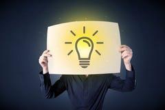Het document van de zakenmanholding met lightbulb Stock Afbeeldingen