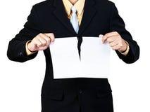 Het document van de zakenmanscheur Royalty-vrije Stock Foto's
