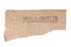 Het document van Grunge met fragiltekst Royalty-vrije Stock Afbeeldingen