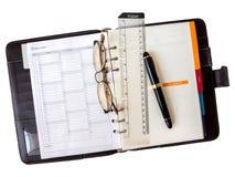 Het document van het notaboek met pen en glazen Royalty-vrije Stock Afbeelding