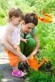 Het doen van het tuinieren Stock Foto