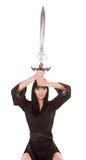 Het donkerbruine zwaard van de vrouwenholding Stock Fotografie
