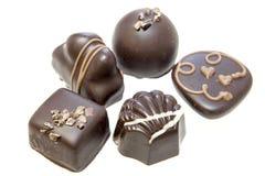 Het donkere Geïsoleerde Assortiment van de Chocolade Stock Foto