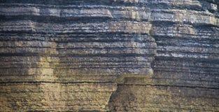 Het doorstane detail van de klippenmuur stock afbeeldingen