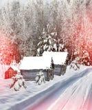 Het dorp in de winterbos Stock Foto