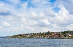 Het dorp Denemarken van de Gudhjemkust Stock Fotografie