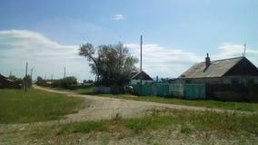 Het dorp in Siberië stock foto