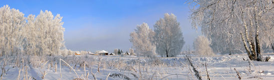 Het dorp van de winter stock afbeelding