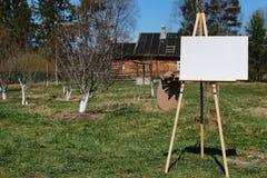 Het dorpslandschap van de schildersezelborstel Stock Afbeelding