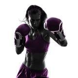 Het in dozen doende kickboxing geïsoleerde silhouet van de vrouwenbokser Stock Foto's