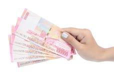 Het dragende geld Indonesië van de hand Stock Foto's