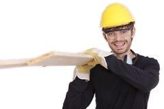 Het dragende hout van de bouwvakker Stock Fotografie