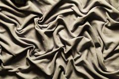Het draperen van de glanzende grijze wijnoogst van de stoffendoek Golvende Achtergrond Stock Afbeelding