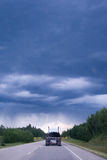 Het drijven in een onweer Stock Afbeeldingen