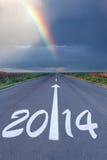 Het drijven van om lege weg onder de regenboog Stock Fotografie