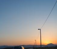 Het drijven in zonsondergang Royalty-vrije Stock Afbeeldingen