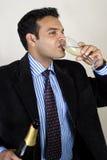 Het drinken aan succes Stock Fotografie
