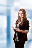 Het drinken van de onderneemster koffie Stock Foto