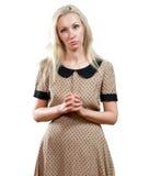 Het droevige meisje in een beige kleding Royalty-vrije Stock Fotografie