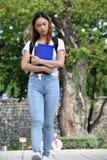 Het droevige meisje van de School met Boeken stock fotografie