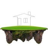 Het dromen huis op drijvend groen land Stock Fotografie