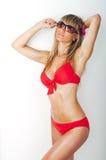 Het dromen van jonge vrouw in zwempak Stock Foto