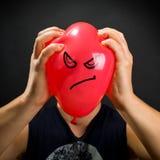 Het drukken van boze ballon Stock Fotografie