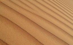 Het duin van het achtergrond woestijnzand patroon stock fotografie