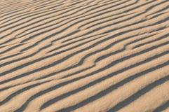 Het duintextuur van het zand Stock Afbeelding