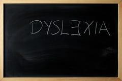 Het dyslexiewoord wordt geschreven op een bord Stock Fotografie