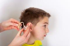 Het eerste gehoorapparaat stock foto's