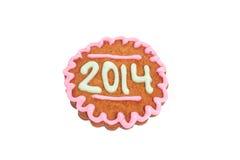 Het eigengemaakte die koekje van 2014 op wit wordt geïsoleerdr Royalty-vrije Stock Foto