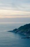 Het eiland in zonsondergangtijden Stock Afbeelding