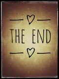Het eind? dat op een oude schrijfmachine en een oud document wordt geschreven Stock Fotografie