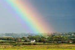 Het eind van de regenboog stock foto