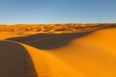 Het eindeloze Overzees van het Zand Awbari - de Woestijn van de Sahara, Libië Royalty-vrije Stock Foto's