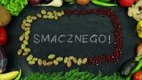 Het eindemotie van het Smacznego Poolse fruit, in Engelse Bon appetit royalty-vrije stock fotografie