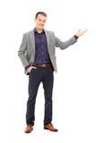 Het elegante mens gesturing met zijn hand Stock Foto