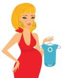 Het elegante zwangere blonde winkelen voor haar toekomstige baby Royalty-vrije Stock Afbeeldingen