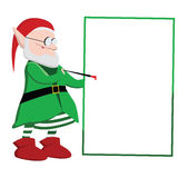 Het elf die van Kerstmis op een lege raad schrijven Stock Afbeelding