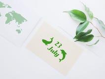Het embleem van de de Dolfijndag van de wereldwalvis 23 juli Stock Afbeeldingen