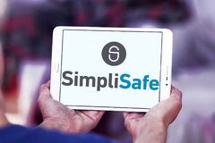 Het embleem van het de veiligheidsbedrijf van het SimpliSafehuis Stock Foto