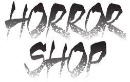 Het embleemmalplaatje van de verschrikkingswinkel Stock Foto's