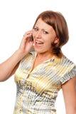 Het emotionele meisje spreekt door een mobiele telefoon royalty-vrije stock afbeelding