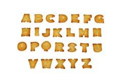 Het Engelse alfabet A-Z maakte van brood, dat op wit wordt geïsoleerds Stock Foto's
