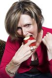 Het eten en de appel van de vrouw Royalty-vrije Stock Afbeeldingen