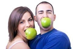 Het eten van appelen stock afbeelding
