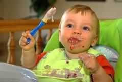 Het eten van baby Stock Foto