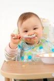 Het eten van babymeisje Royalty-vrije Stock Afbeelding